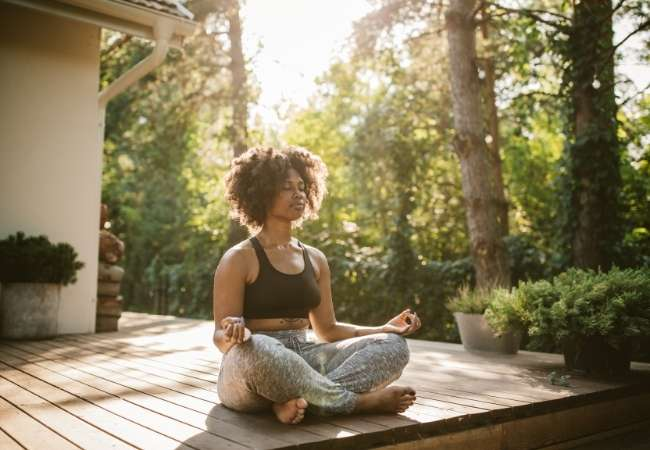 woman does yoga in summer